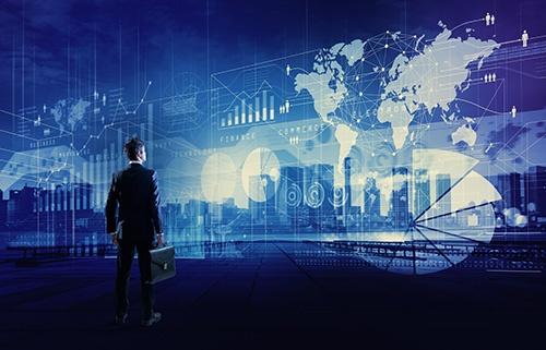 businessman looking at charts-blog