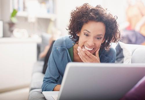 woman on laptop smiling-blog