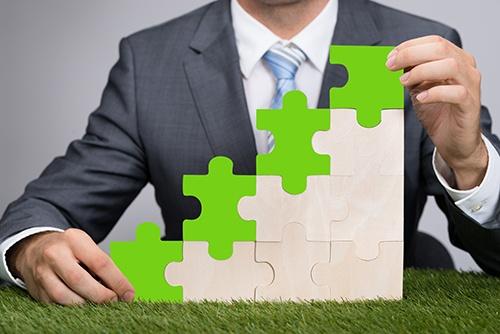 businessman puzzle green blog.jpg