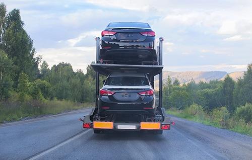 cars on truck - blog.jpg