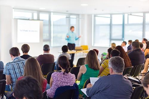 speaker at conference hall-blog