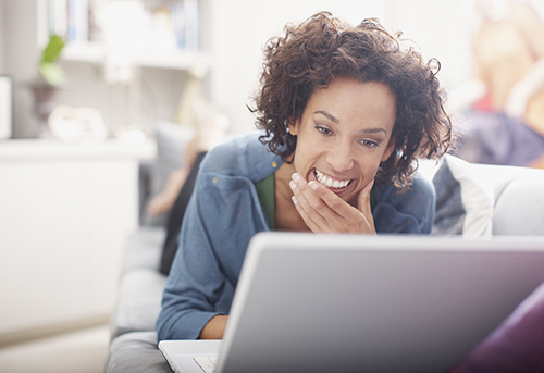 woman on laptop smiling-blog